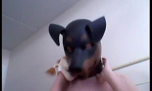 Kinky Girl gets off wearing a rubber dog mask