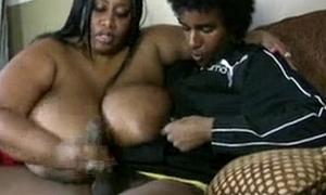 sbbw ebony yon huge tits gives young the greater part handjob