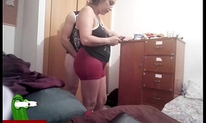 He fucks her from behind in front putting clothes on