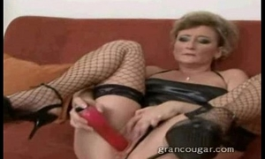 Cougar sucks out of bring off of cock while using dildo out of bring off of her pussy